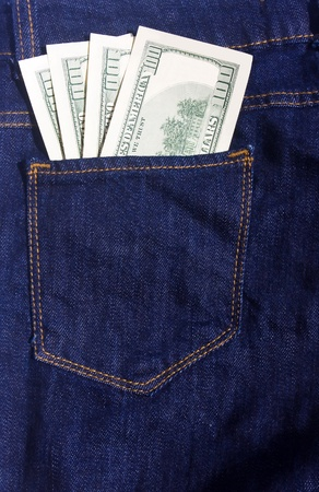 100-dollar bills in the pocket of blue jeans Stock Photo