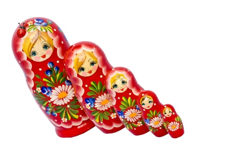 nested: A set of five red Matryoshka nested dolls.