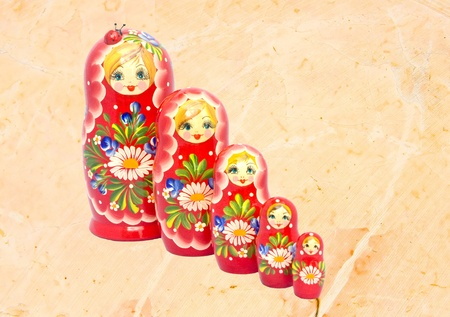 Russian traditional Babushka doll family on marble background photo