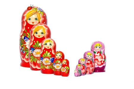 Two families of famous Russian Matryoshka (Babushka) dolls ranking small to large. photo
