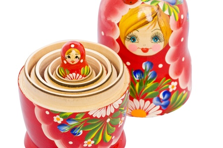 small red matryoshka doll nested in the big one (close up) Stockfoto