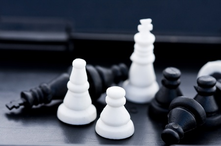 Chess pieces piling in a box after game. Stock Photo