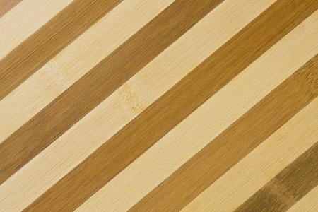 A texture of dark and light diagonal wooden stripes.