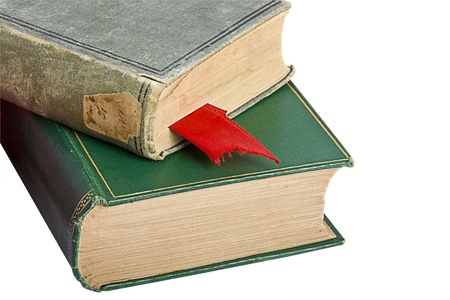 Two old books with a red bookmark isolated on white.
