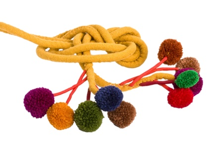 pompon: Yellow handmade woolen belt with colorful pompons over white background