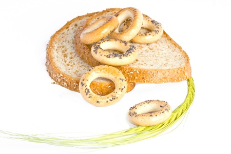 Various types of appearance for bread  wheat spike, round cracknels, slices of baked bread  Stock Photo - 13146843