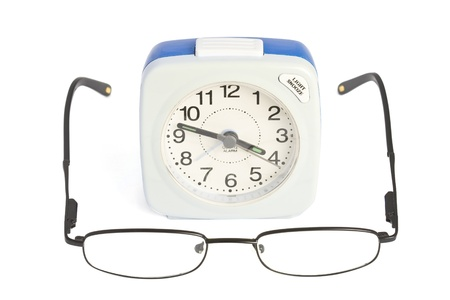 beeping: Alarm clock and glasses over white background