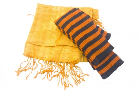 leg warmers: Warm yellow scarf and striped orange-black leggings over white background