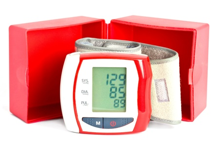 wrist cuffs: Wrist blood pressure meter with box and data on the display. Stock Photo