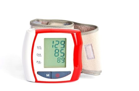 Red blood pressure meter with data on the display  with shadow   photo