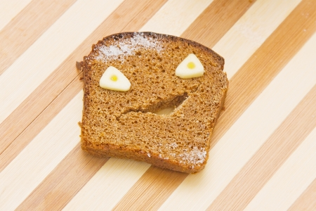 Funny monster made of rye bread and garlic pieces Stock Photo - 14360828