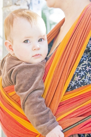 Cute baby girl sitting in the sling Stock Photo - 14447372