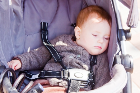 Cute baby girl sleeping peacefully in the carriage  Stock Photo