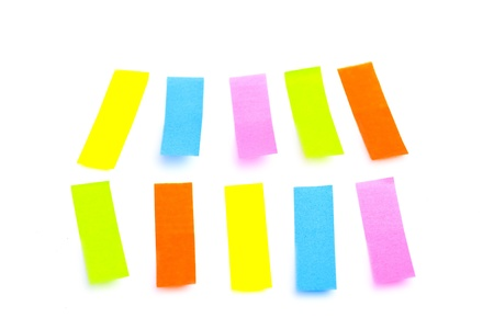 Rainbow-color thin sticker set on the white surface  with shadows