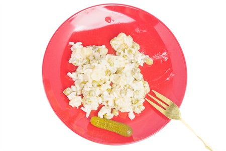 Red plate with vegetable salad isolated over white background