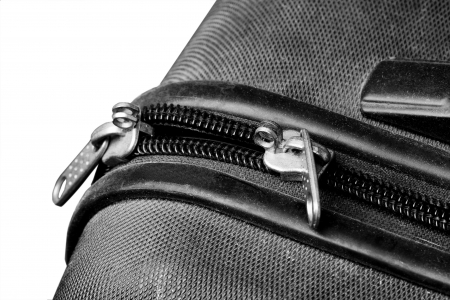 Closeup on a zipper of a black plastic suitcase photo