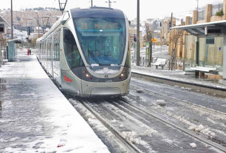 anomalies: JERSUALEM, Israel - January 10th, 2013: A city train standing on the train stop in North Jerusalem during the massive snowfall in Jerusalem, Israel