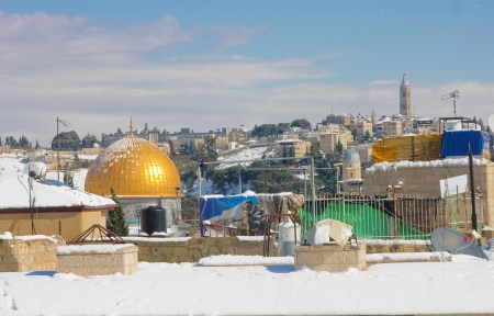 anomalies: JERUSALEM - JANUARY 10: Rooftops facing the Omar Mosque on the Temple Mount in the Old City of Jerusalem covered in snow after the massive snowfall in Jerusalem, Israel on January 10, 2013