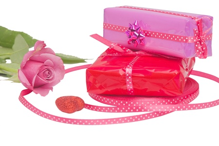 Couple of wrapped Valentine s gifts and a rose photo