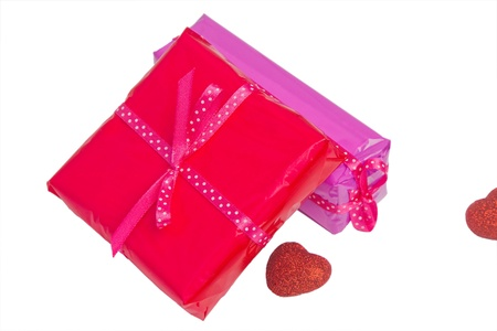 Two wrapped gift concept and decoration heart isolated photo