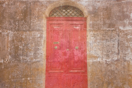 Retro wallpaper with a vintage red door  photo