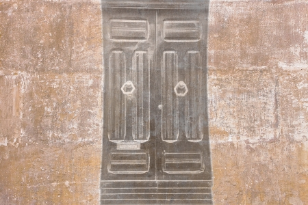 mistery: Retro wallpaper with a vintage black door  Stock Photo