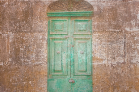 Retro wallpaper with a vintage green door  photo