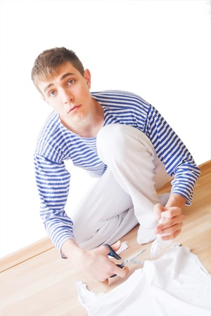 unawares: Alerted twenty year young man cutting a T-shirt