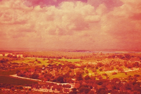 Unrealistic vintage landscape picture in red and purple tones photo