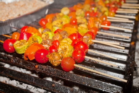 Vegetable barbecue with meat on skewers on the grill photo