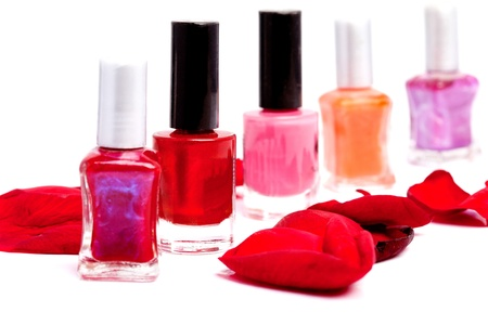 laque: Closeup on variety of nail polish bottles with different shades of red polish  shallow depth of field