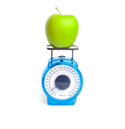 weight control: Green apple on scale  weight control concept