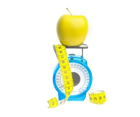 unattached: Apple diet concept with scale and centimeter