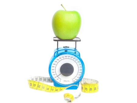 Fresh green apple on a scale with a centimeter isolated Stock Photo