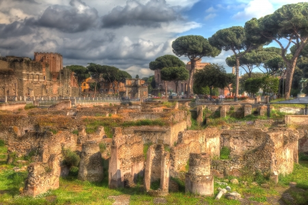 archaeological: Grungy vintage picture of archaeological site near via dei Fori Imperiali in Rome styled as Renaissance Toscan landscape.