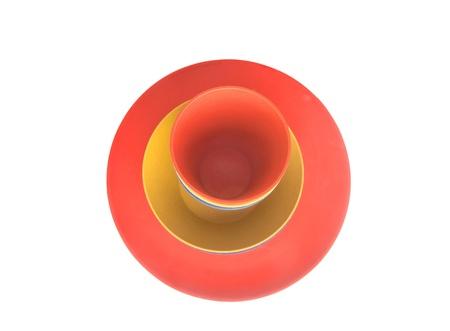 Triple dishware set of orange-yellow colors isolated on white photo