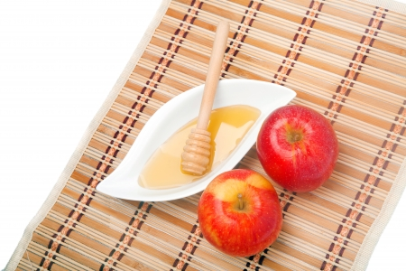 Apples and honey - a Jewish New Year celebration snack - on a straw mat  photo