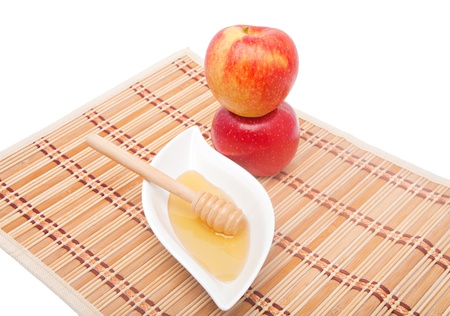 Tower of two apples and honey with dipper for Rosh Hashana photo