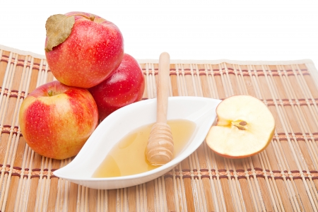 Postcard for Jewish New year with traditional apple and honey snack and fit space for text photo
