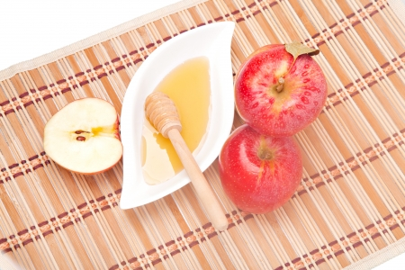 Apple half and saucer of honey with red apples (view from above) photo