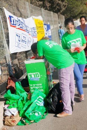 JERUSALEM - OCTOBER 22: Young people work at campaign stands of Merets (Energy) party deployed near the ballot station in Jerusalem during the mayor elections on October 22, 2013, the mayor elections day in Israel.