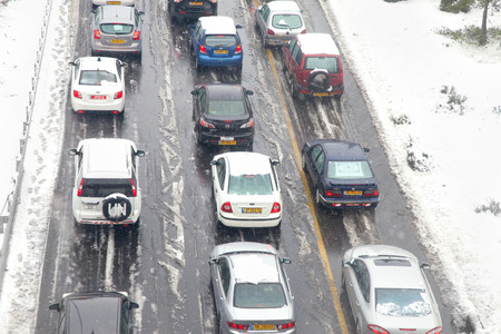 anomalies: JERSUALEM, Israel - December 12, 2013: Traffic jam on the city main highway caused by unexpectedly massive snowfall in Jerusalem, Israel Editorial