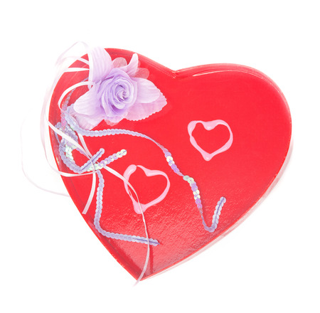 Two lipstick-drawn hearts and an textile flower in a big red Valentines day heart isolated on white