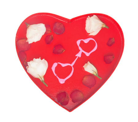 Loving hearts concept with two hand-drawn pink hearts and white rose buds on red Valentine day heart-shaped background; isolated on white