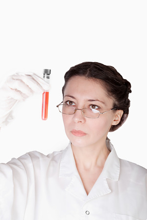 analyzed: Lab test sample being analyzed by a female lab researcher isolated on white