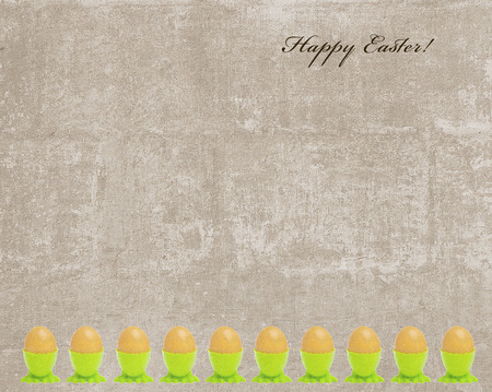 Vintage Easter card with a frame made of golden eggs and Happy Easter sign photo