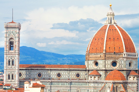 duomo of florence: Duomo of Florence with the Giotto Beltower over sky with clouds