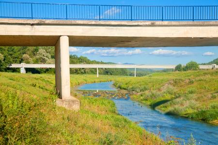 Rural scenic with a bridge over a small stream Stock Photo