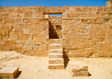 Stone doorway and single staricase in a ruined ancient palace in Nabathean city of Mamshit (Negev Desert, Israel) photo