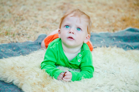 awe: Portrait of a cute startled baby boy staring up in awe